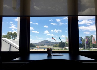 Looking over the lake, Anzac Parade and Mt Ainslie. Not a bad view for your office
